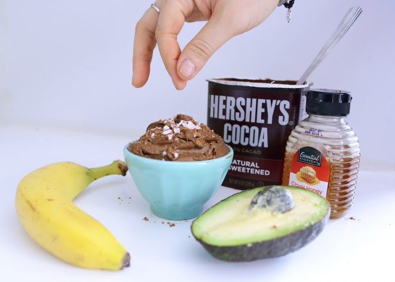 Simple, creamy and nutritionally-dense, this chocolate peanut butter avocado pudding, garnished with cocoa powder and sea salt, is a minimalist baker's dream.