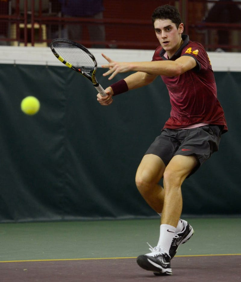 Freshman Felix Corwin volleys the ball at the Baseline Tennis Center on Friday against Washington.