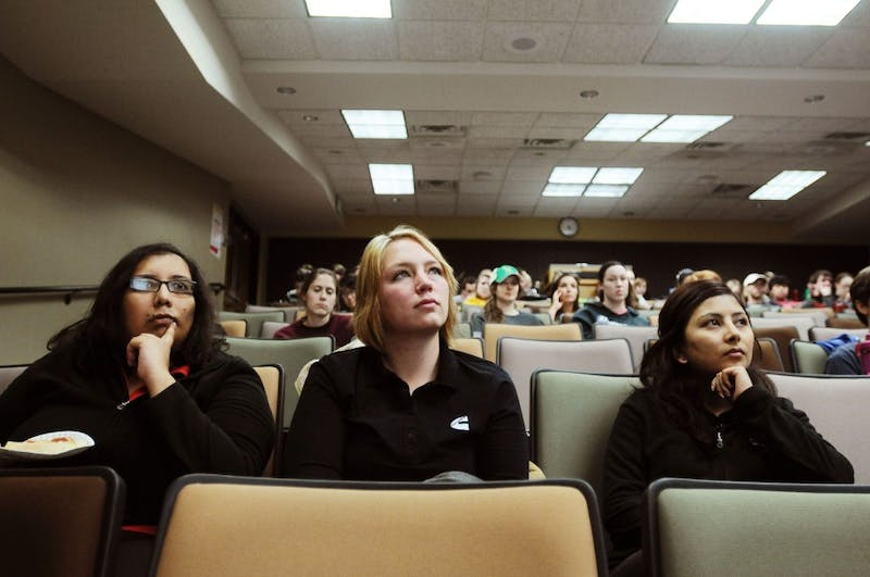 Cummins engineers Shreyasee Kambale, Taya Upkes and Ashika Shrestha listen to one of their employees talk to the Society of Women Engineers on Monday evening at Tate Laboratory.  Cummins is a sponsor of the Society of Women Engineers.