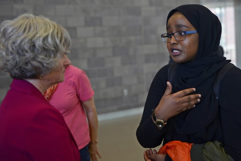 Samaya Mohamed right, speaks with Teddie Potter after the campus conversation ended on Thursday, Oct. 6, 2016 at the University Recreation and Wellness Center. Samaya was one of the protesters that spoke in front of the crowd addressing President Kahler's email that made her personally feel unsafe from it.