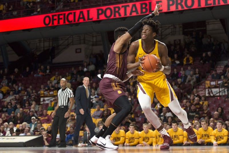 Center Daniel Oturu drives towards the hoop at Williams Arena on Thursday, Nov. 1. The Gophers defeated the Bulldogs 109-53.