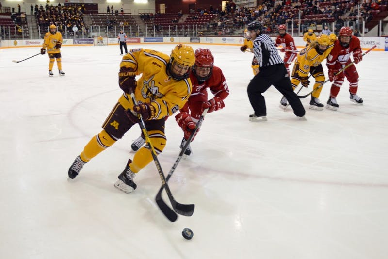 Forward senior Caitlin Reilly skates down the ice with puck at Ridder Arena on Sunday, Oct. 29.