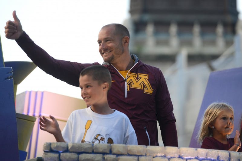 Head football coach P.J. Fleck leads the 17th annual CenterPoint Energy Torchlight Parade as Grand Marshal along Hennepin Avenue on Wednesday.