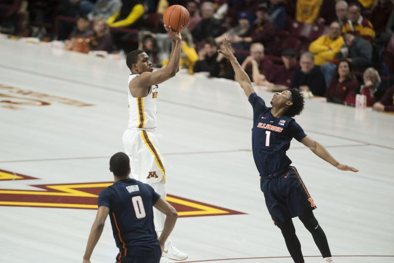 Sophomore Isaiah Washington shoots from the top of the key at Williams Arena on Wednesday, Jan. 30. The Gophers beat the Illinois Fighting Illini 86-75.