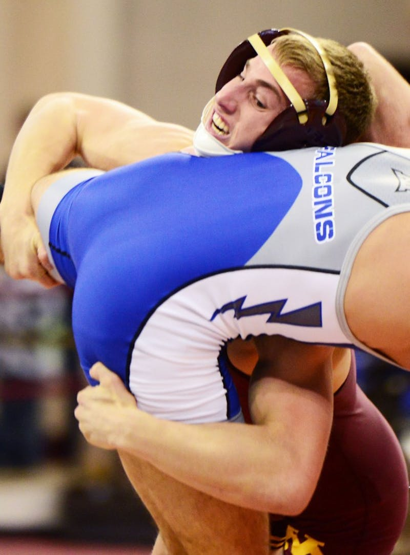 Tommy Thorn contends against Air Force wrestler David Walker in the 141-pound weight class matchup at the Sports Pavilion on Nov. 21.