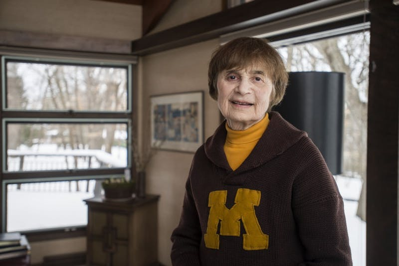 University Regent Linda Cohen poses for a portrait on Saturday, April 13 in her home in Minnetonka. The cardigan she is wearing was her father, Louis Gross' from his time at the University in the 1920s.