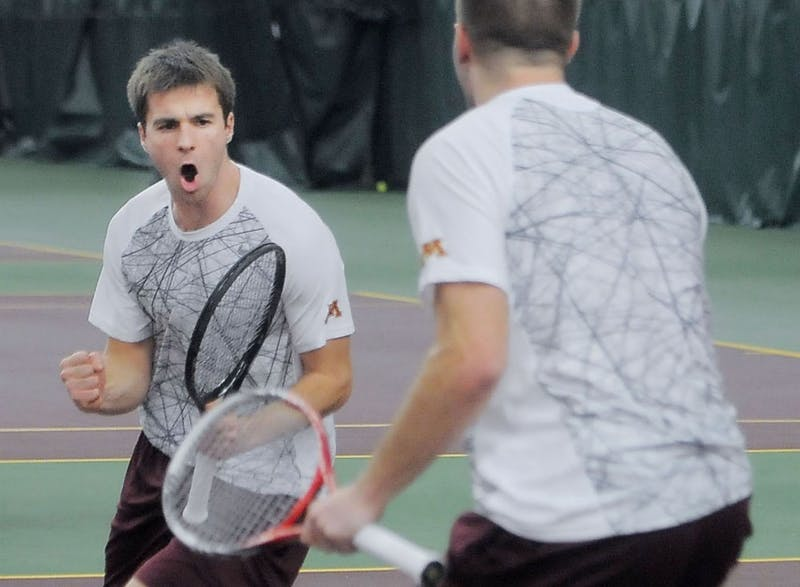 Minnesota doubles partners Mathieu Froment and Jack Hamburg celebrate after a victory against Tulsa on Friday, Dec. 10, 2013 at the Baseline Tennis Center.