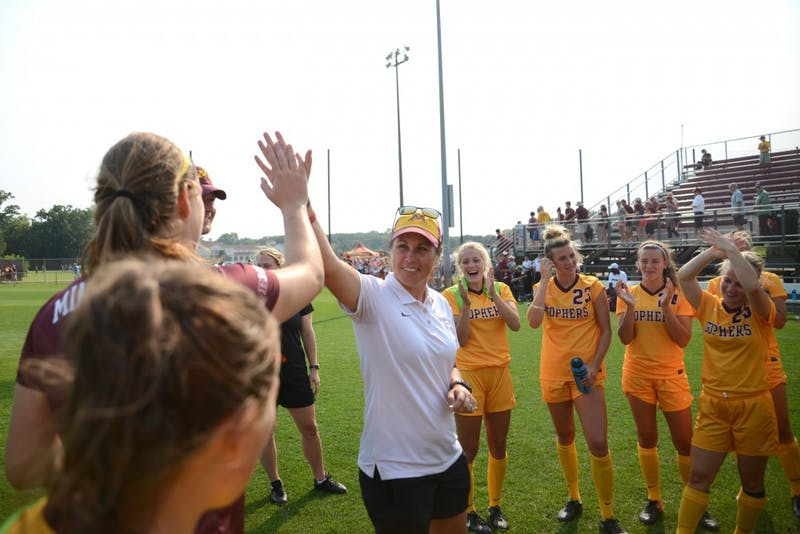 The Gophers soccer team celebrates a 1-0 victory against Providence in overtime on Sept. 3 at Elizabeth Lyle-Robbie Stadium.