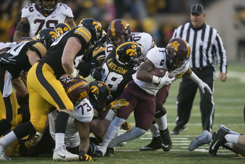 Running back Rodney Smith attempts to break through the line of scrimmage while running the ball at Kinnick Stadium on Saturday, Oct. 28.