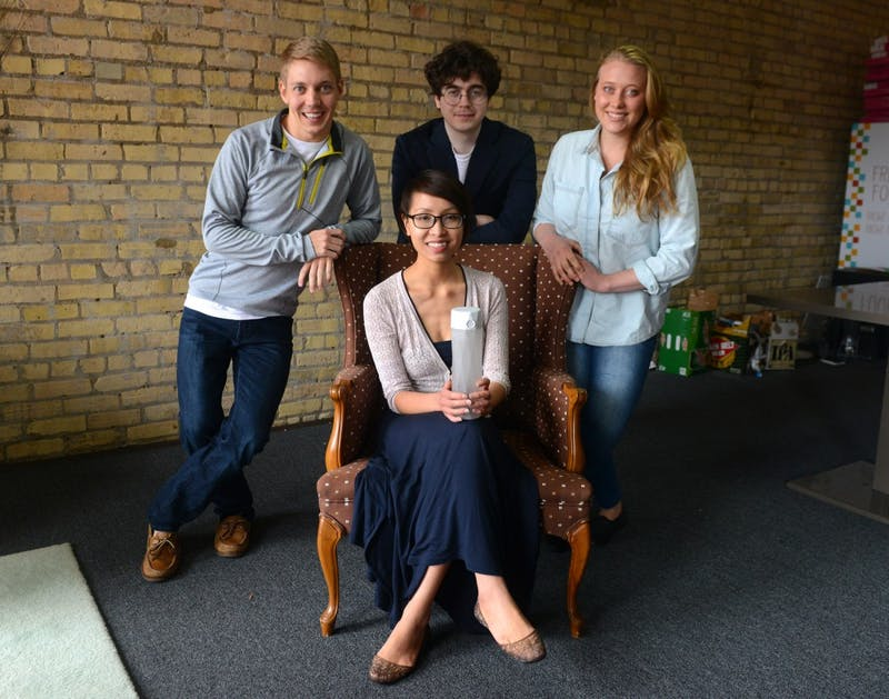 Coleman Iverson, Alexander Hambrock, Alexandra Feeken, and Nadya Nguyen pose in their workspace in Minneapolis on Saturday, June 13. They are four of five University alumni who have invented the HidrateMe water bottle.