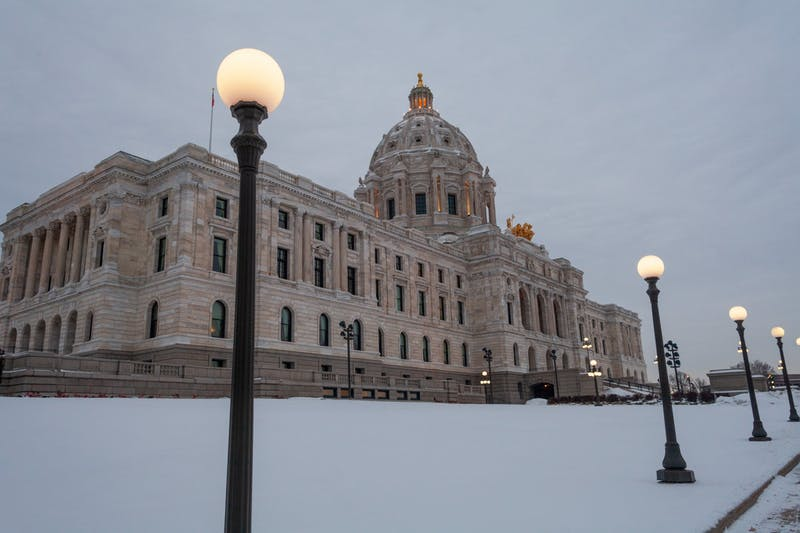 Dawn breaks over the Minnesota State Capitol Building on Wednesday, Jan. 15. (Kamaan Richards / Minnesota Daily)