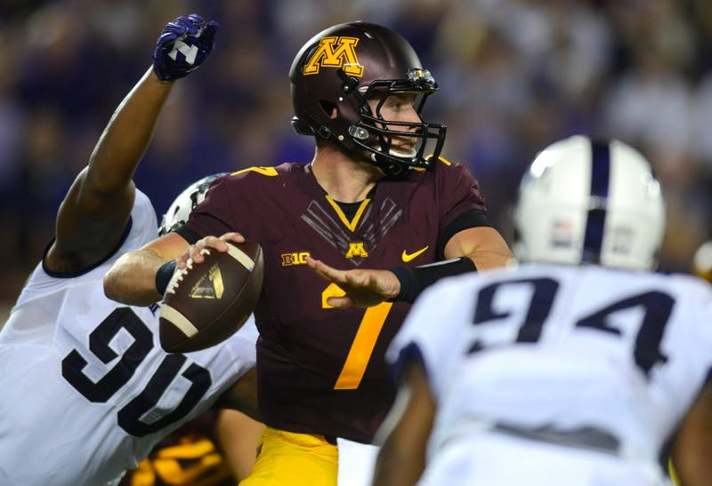 Minnesota quarterback Mitch Leidner faces pressure from Texas Christian University on September 3, 2015. The Gophers played against Colorado State University on Saturday where they won 23-20.