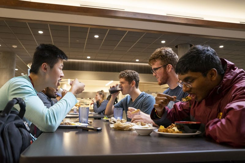 From left, Mike Lau, Roudra Bhattacharya, Nathan Hafey, Matt Legler and Jeevan Prakash enjoy a meal in the newly renovated Pioneer Dining Hall on Wednesday, Sept. 11. Pioneer replaces Centennial as the only dining hall available to students living in Superblock.
