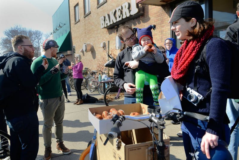 "Bicyclists of all ages gather for doughnuts at the end of Calhoun Cycle's Pastry Ride at A Baker's Wife on Saturday. The ride is a part of ""30 Days of Biking,"" a yearly event in which people pledge to ride their bikes every day of April."