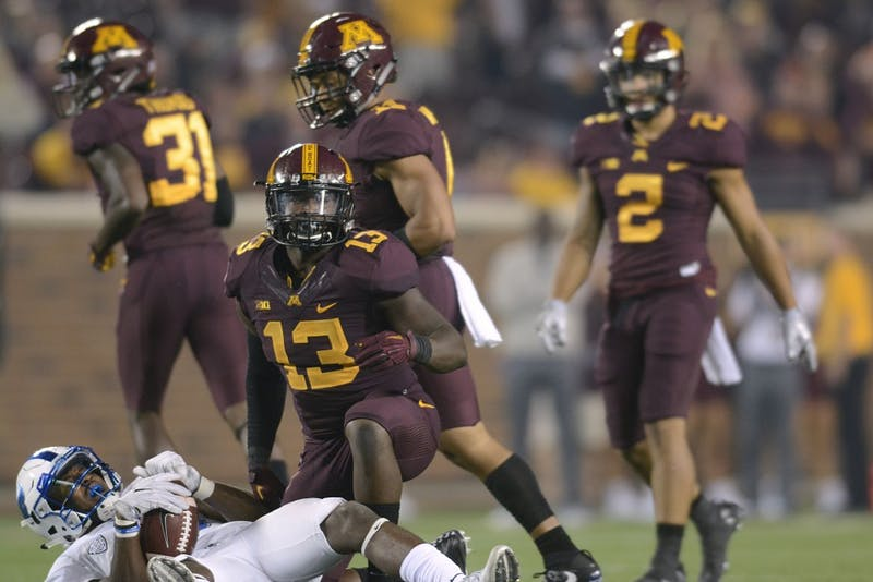 Linebacker Jonathan Celestin gets up from tackling a Buffalo player on Thursday, Aug. 31, 2017 at TCF Bank Stadium in Minneapolis. The Gophers beat Buffalo 17-7.