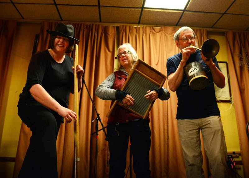 "Jug band musicians, left to right, Amanda ""Standalone"" Nygard, Kris Garwick and Bob Fyfe play a song together at Eagles Club #34 on Friday, Feb. 5. This weekend marks the 34th annual Battle of the Jug Bands, which will be held at the Cabooze on Feb. 13 and 14."