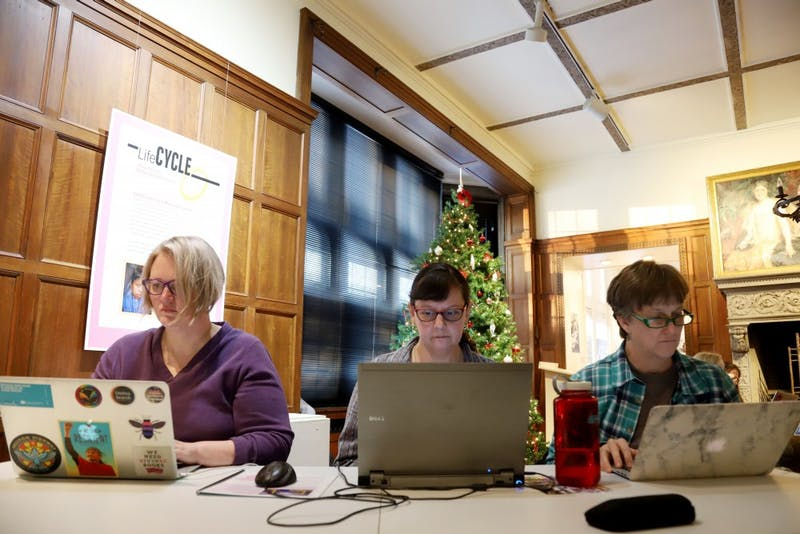 Kim Doyle, Becah Padilla and Martha Hardy research for the Mapping Prejudice Plan on Sunday, Dec. 9 at the Hennepin History Museum in Minneapolis. Part of their job is to find out how the plan will effect the Minneapolis 2040 plan.
