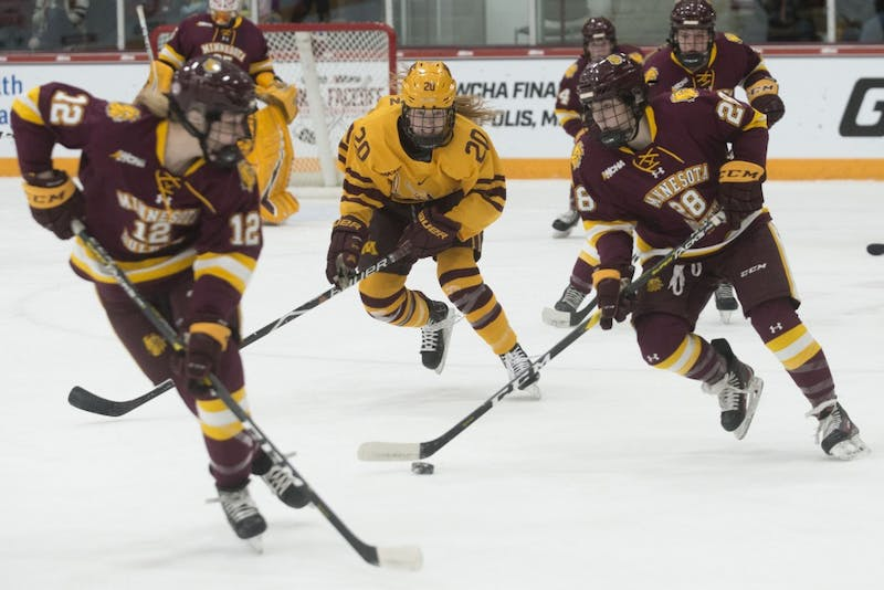 Forward Alex Woken chases after the Bulldogs on Saturday, March 9 at Ridder Arena. The Gophers defeated Minnesota Duluth 4-1 to advance in the WCHA Final Faceoff.