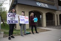 Members of the University Pro-Choice Coalition protest outside of the First Care Pregnancy Center on Monday, April 29 in Minneapolis.