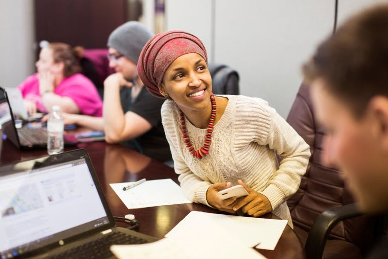 Surrounded by volunteers and field staff, Ilhan Omar prepares to go door-knocking on Monday in her Minneapolis office.