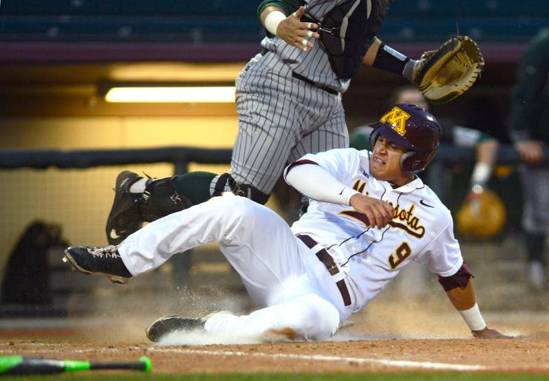 Freshman infielder Eddie Estrada slides through home plate at Siebert Field on Tuesday. After six innings with no runs during a game versus North Dakota State, the Gophers scored seven runs in the seventh inning, later closing the match 10-0.