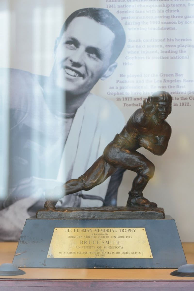 The Heisman award sits on display in Gibson/Nagurski Football Practice Facility on Wednesday, July 26. Halfback Bruce Smith won the award in 1941.