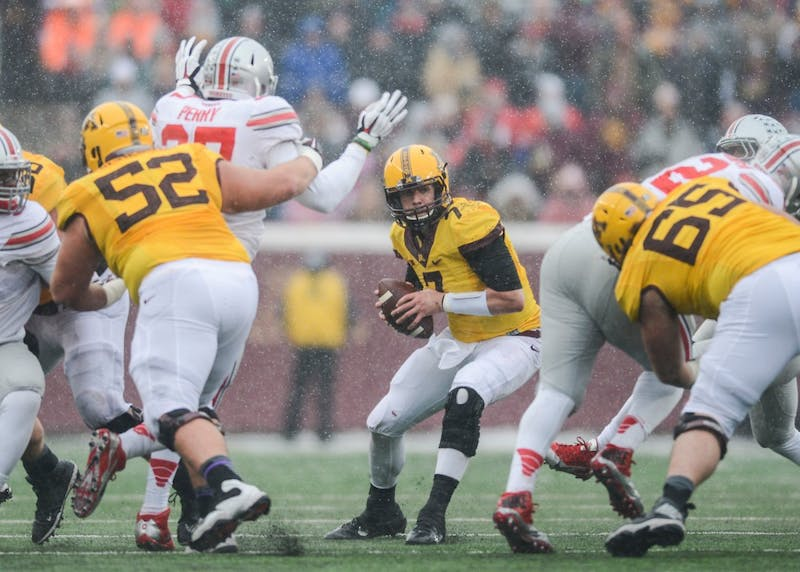 Gophers quarterback Mitch Leidner searches for someone to pass to on Nov. 15, 2014 against Ohio State at TCF Bank Stadium.