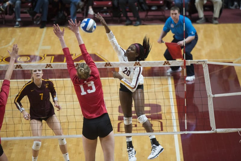 Freshman Adanna Rollins jumps to spike the ball at Maturi Pavilion on Friday, Nov. 9. The Gophers swept Indiana in all three sets.