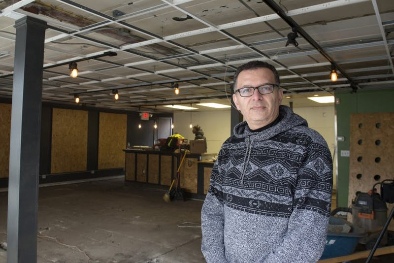 Owner of Wally's and Hideaway, Wally Sakallah, stands in the doorway of the space that was to be Cosmic Bean Dispensary. Construction is currently underway inside the building, which is next to Hideaway.