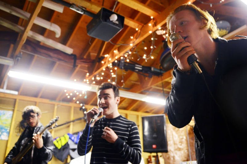 Ian Underhill-Cady, right, Max Finch-Raymond, center, and Toivo Hannigan, left, of hip hop group Pseudoubt rehearse in their garage in south Minneapolis on Tuesday. Pseudoubt are one of multiple musical acts within the family of Desoplex Records, an art collective formed by current high school seniors.