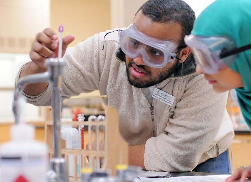 Normandale students Mohamed Hassan and Quadsia Anjum work on a chemistry lab on Monday, April 22, 2013, at Normandale Community College in Bloomington. Hassan is one of many students that are interested in transferring to the University of Minnesota, although retention in the admissions process could make that transfer more difficult.