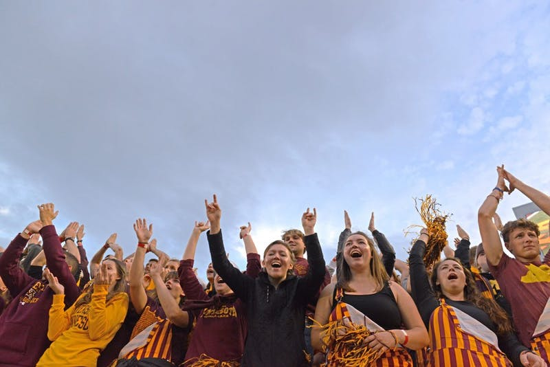"Gophers fans raise their arms to DJ Khaled's ""All I Do is Win"" on Saturday, Oct. 21 at TCF Bank Stadium. The University enrolled 6,195 new freshmen this fall, on top of almost 2,300 transfer students, the largest class in almost 50 years."