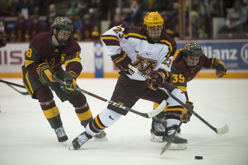 Forward Ryan Norman skates after the puck at 3M Arena at Mariucci on Friday, Mar. 1. The Gophers defeated Arizona State 5-1.