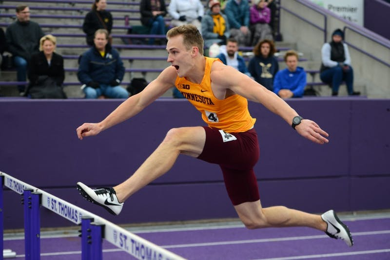 Freshman Teddy Frid runs in the 110-meter hurdles on Thursday evening at St. Thomas.