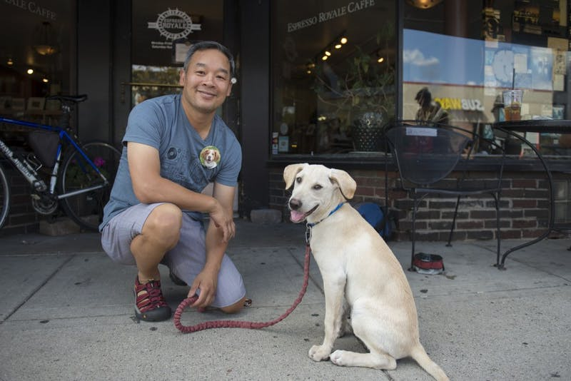 Louie Tran and his new dog Jaspen sit outside Espresso Royale in Dinkytown. Louie Tran is a regular at Espresso Royale with his old beloved dog Chip.