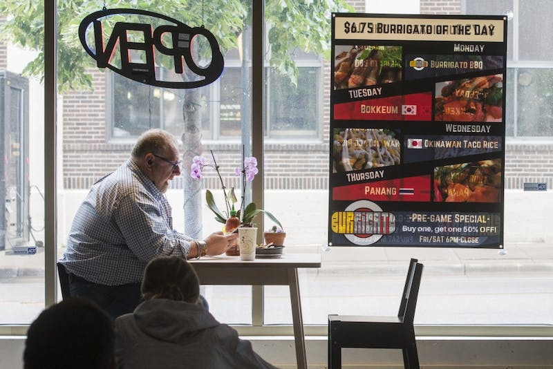 Customers eat at Burrigato on Tuesday, June 26. Burrigato opened in April 2017 and features a unique menu of Asian burritos.