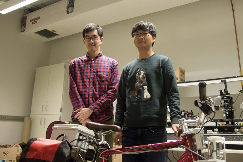 Zhenming Xiem, left. and Woongsun Jeon, right, pose for a portrait in the Mechanical Engineering building on Monday, Nov. 4. Xiem and Jeon have been working on a prototype bike system since 2015 to help improve cyclist safety.