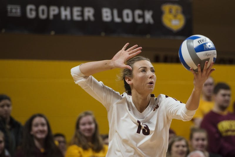 Senior Samantha Seliger-Swenson prepares to serve the ball at Maturi Pavilion on Friday, Nov. 9. The Gophers swept Indiana 3 sets to none.