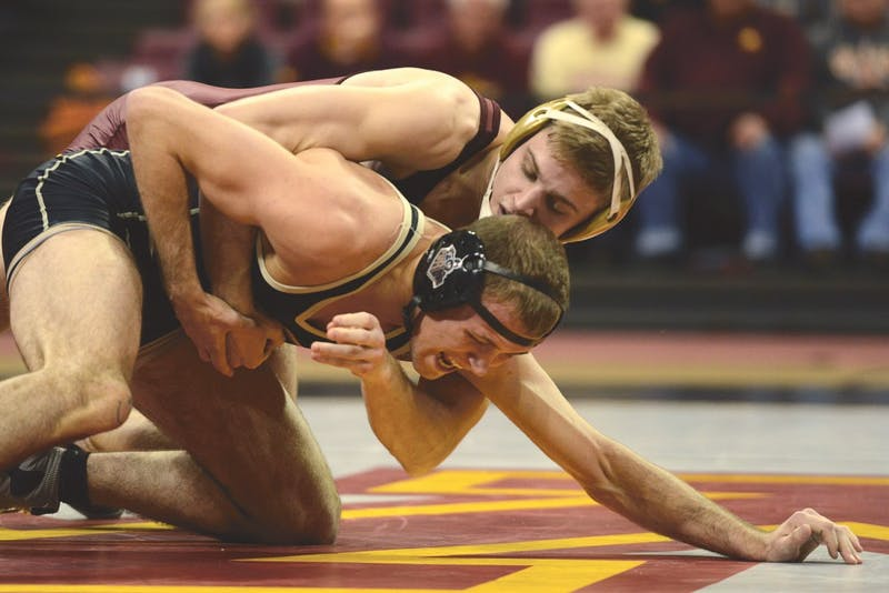 Sophomore Nick Wanzek contends against Jacob Morrissey of Purdue in the 174-pound weight class matchup at the Sports Pavilion on Sunday, Jan. 24.