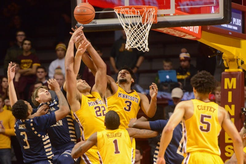 Offensive players Reggie Lynch and Jordan Murphy attempt to score on Friday, Dec. 9, 2016 at Williams Arena.