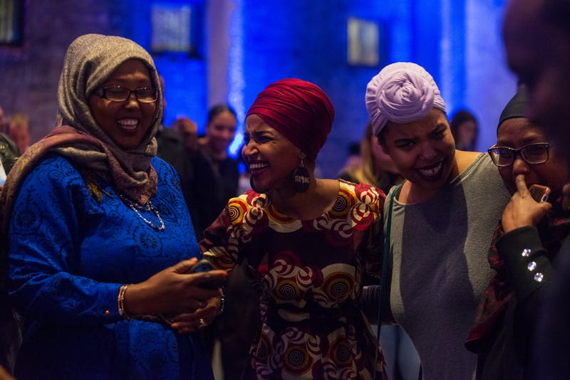 """Congresswoman Ilhan Omar chats with attendees at Ilhan Omar 2020 Reelection Kickoff: """"Send Her Back to Congress"""" at Aria in Minneapolis on Thursday, Jan. 23. (Nur B. Adam / Minnesota Daily)"""