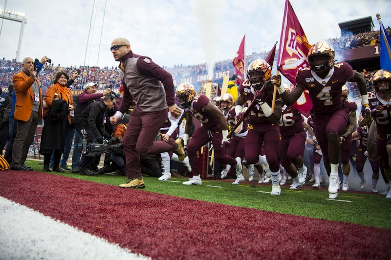 Head Coach PJ Fleck leads the team out of the tunnel at TCF Bank Stadium on Saturday, Nov. 9. The Gophers defeated Penn State 31-26 to bring their record to 9-0. A first since 1904.