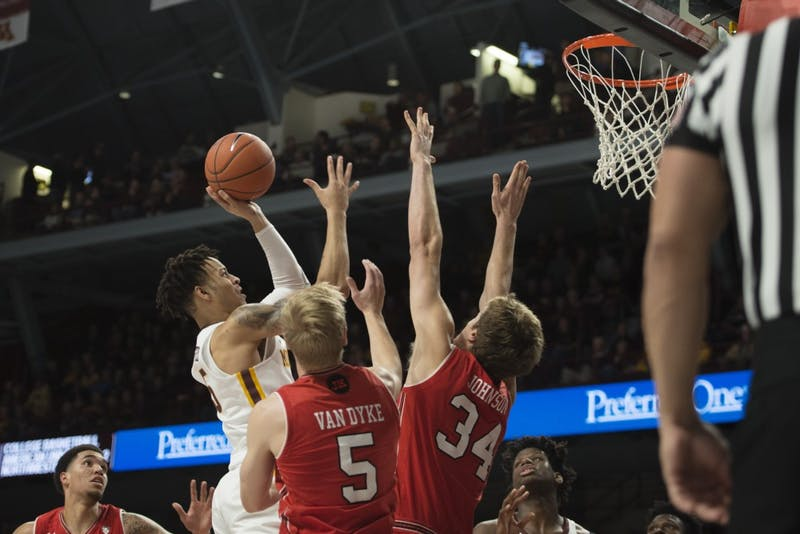 Junior Amir Coffey jumps for the layup on Monday, Nov. 12 at Williams Arena. The Gophers beat the Utes 78-69 and Coffey finished with 14 points.