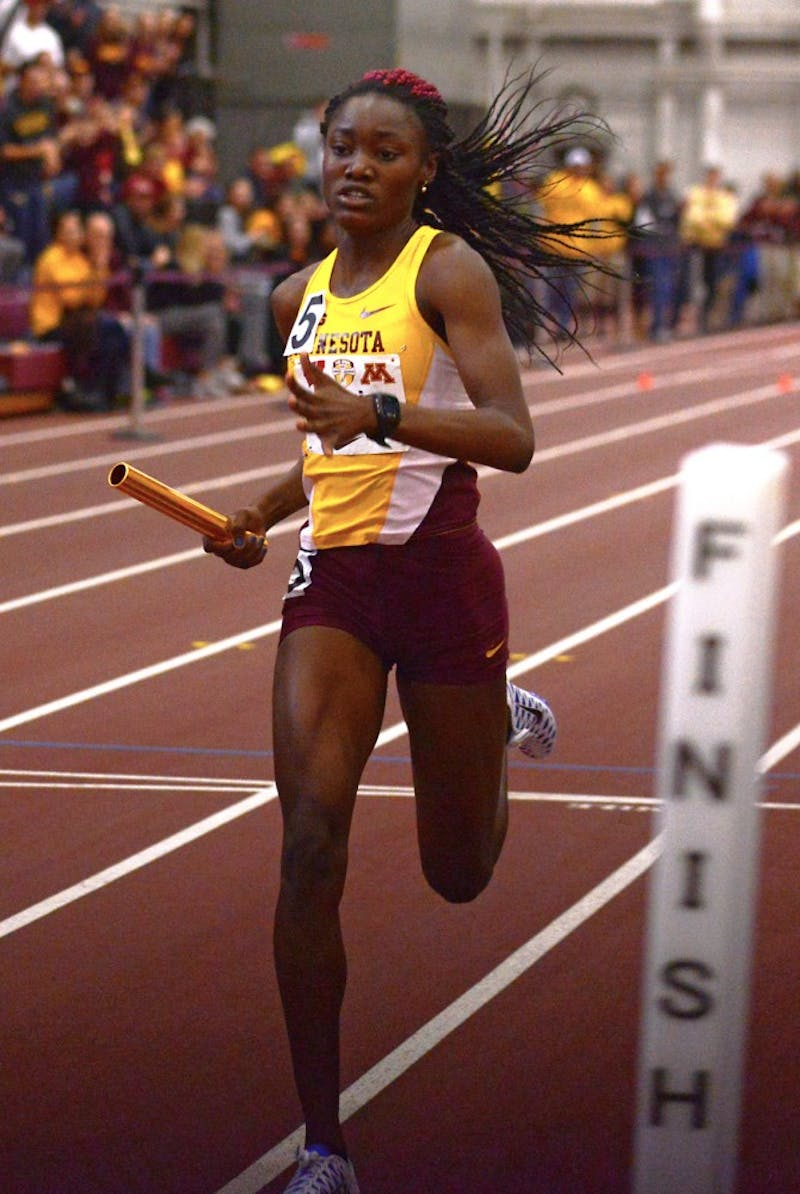 Titania Markland is cheered on as she crosses the finish line to win the women's 400-meter relay, the last event at the University of Minnesota Field House for the second annual Minnesota-Wisconsin Dual on Jan. 23.
