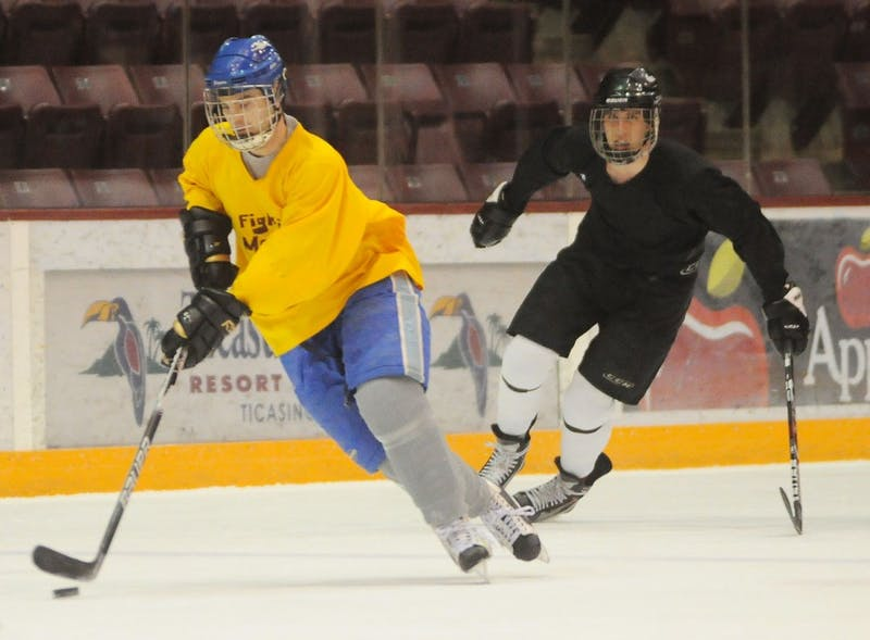 The Fighting Mondales play the University ROTC team in intramural hockey Monday, Feb. 10, 2014, at Mariucci Arena.