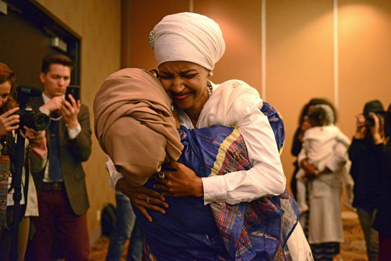 Campaign volunteer Habon Abdulle embraces Ilhan Omar on Tuesday, Nov. 8, 2016 at the  Courtyard Marriott on West Bank in Minneapolis. Omar won the seat for House 60B.