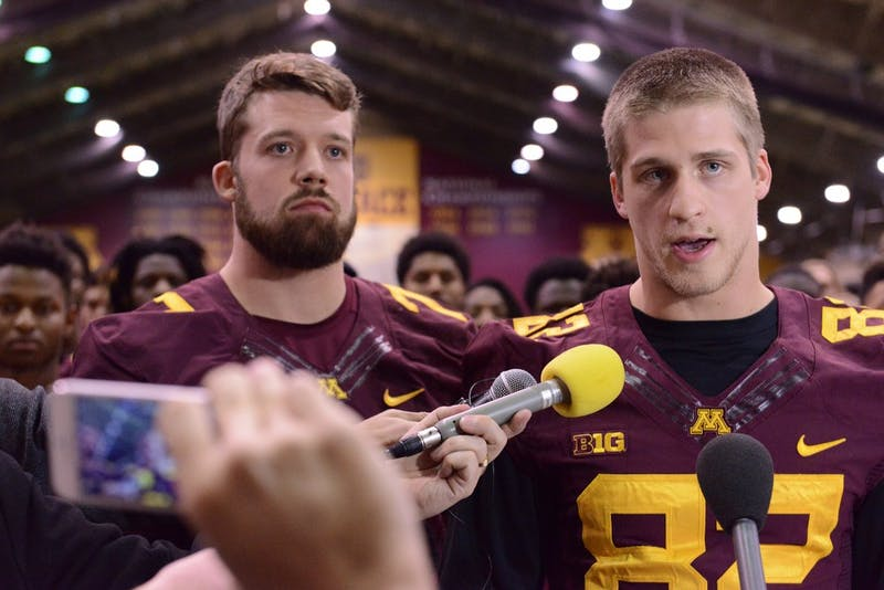 Senior wide receiver Drew Wolitarsky, right, recites a prepared statement for reporters on Thurs. Dec. 15, 2016 as quarterback Mitch Leidner, left, stands next to him at the Gibson-Nagurski Football Complex.