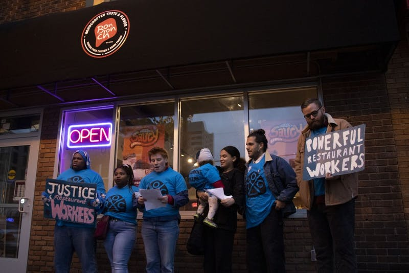 Erin Lynch of the Restaurant Opportunities Center of Minnesota announces a recent settlement for alleged stolen wages outside of Bonchon in Dinkytown on Tuesday, Oct. 22.