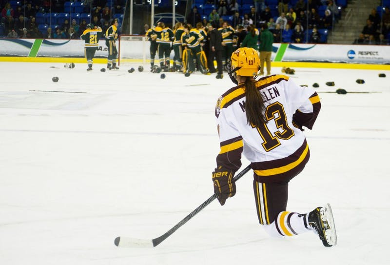 Minnesota defenseman Milica McMillen watches Clarkson players celebrate their NCAA title win Sunday, March 23 at TD Bank Sports Center in Hamden, Conn. The Gophers won the previous two NCAA titles.