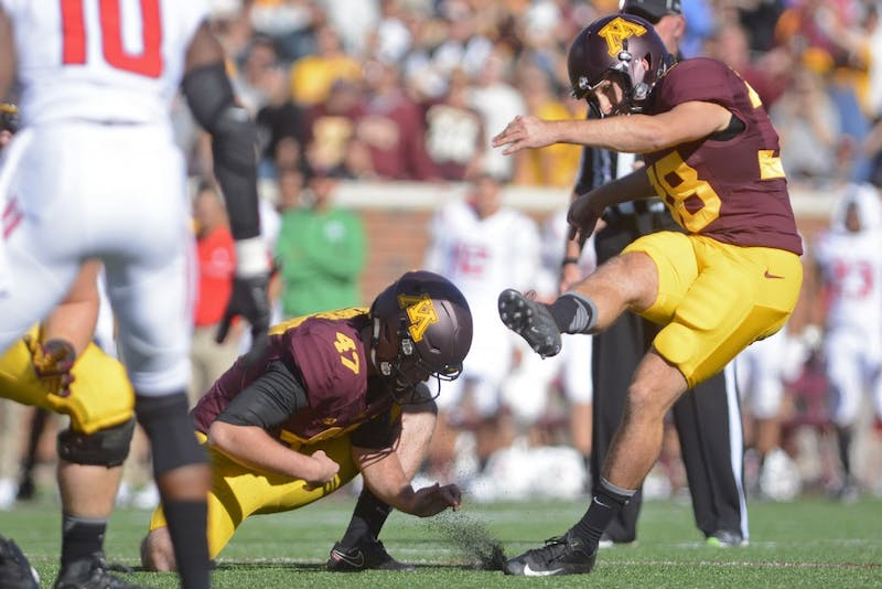 Gophers kicker Emmit Carpenter kicks the ball on Saturday at TCF Bank Stadium.